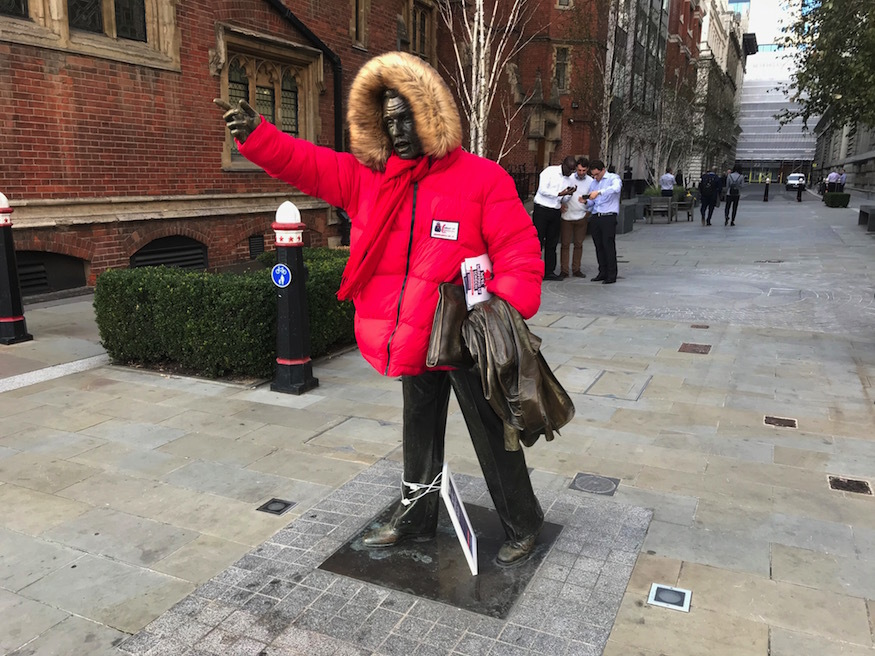 A statue wearing a coat.