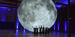 Do Yoga Beneath A Giant Moon At The Natural History Museum