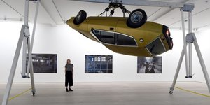 There's A Car Spinning On The Ceiling At This Trippy Exhibition About Rave Culture