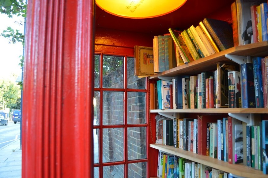 A phone box full of books in Lewisham.