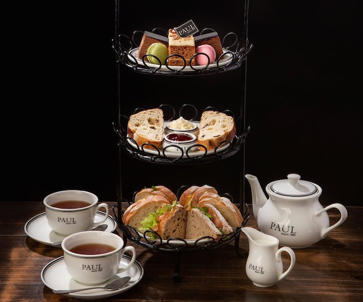 French themed afternoon tea on a three-tiered stand at Paul bakery and patisserie
