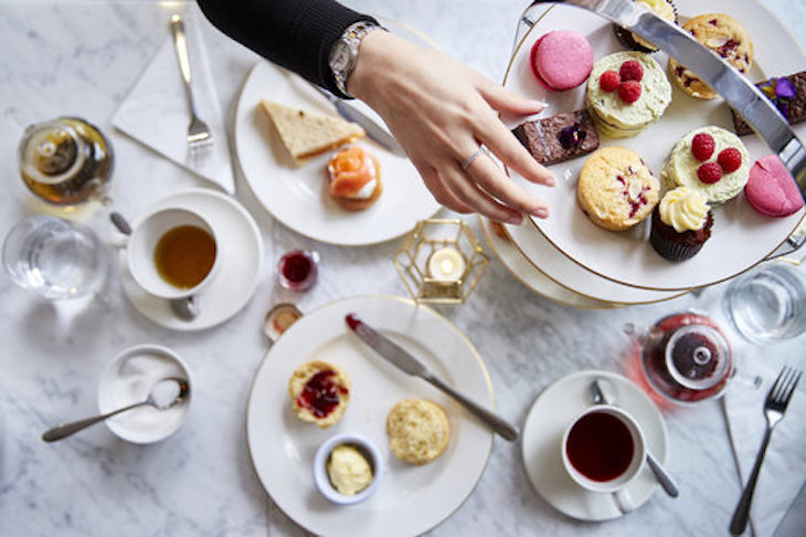 Afternoon tea laid out on a table at Bea's of Bloomsbury near St Paul's Cathedral