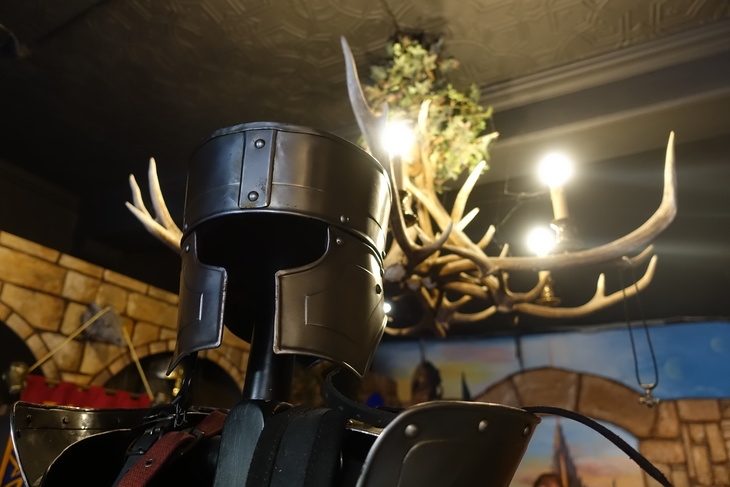Ancient helmet and stag chandelier