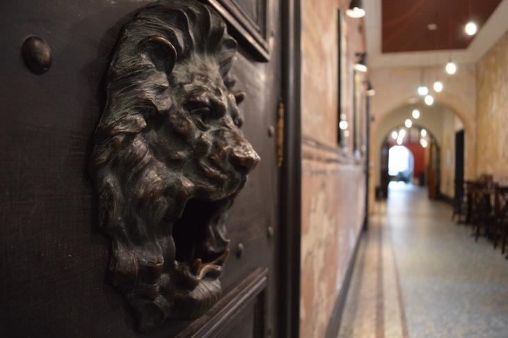 Lion's head on a door in BAC