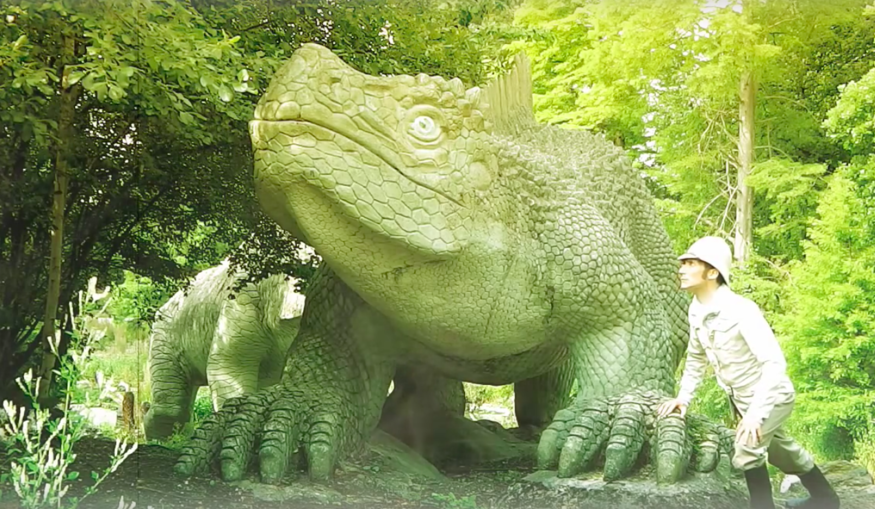 Dinosaurs with stereotypical explorer in Crystal Palace Park.