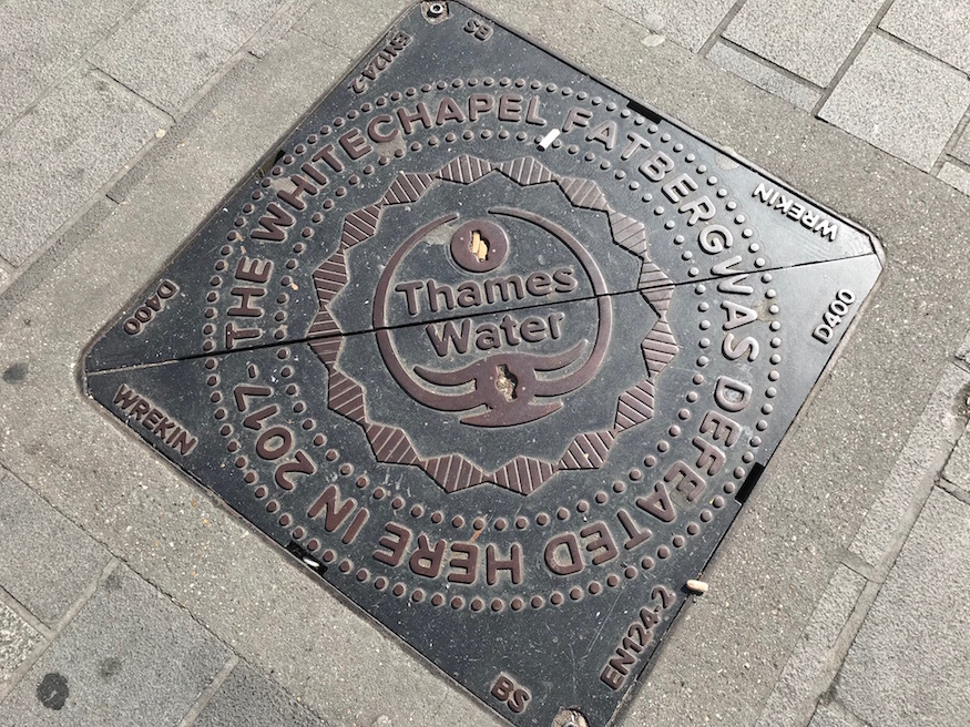 A manhole cover commemorating the fatberg of Whitechapel