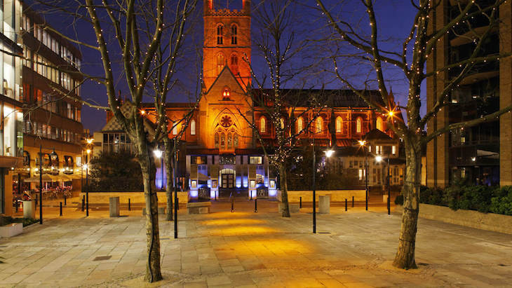 Southwark Cathedral exterior illuminated with Christmas lights for the Marie Curie Cancer Care Christmas carol concert