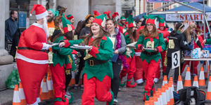 People Race Round Covent Garden Dressed As Elves And Carrying A Christmas Pudding In This Mad Festive Event