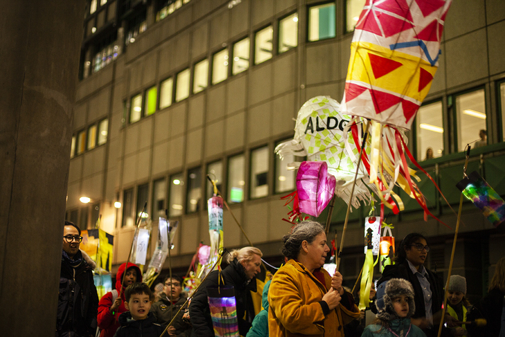 Aldgate lanterns being held aloft