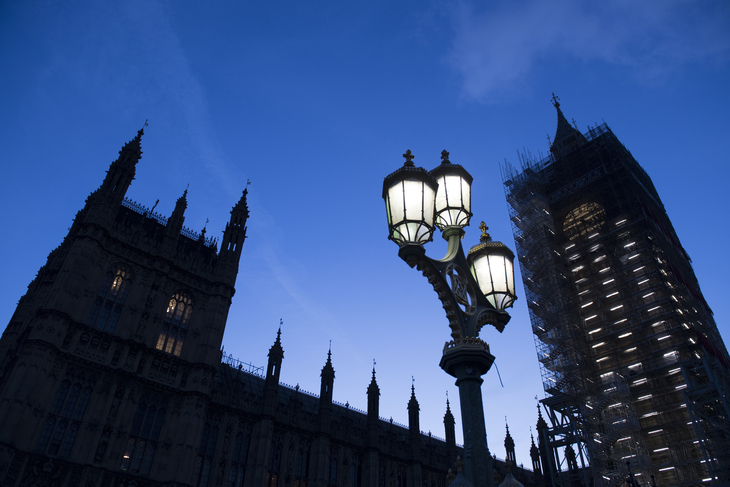 Houses of Parliament at night with lamp