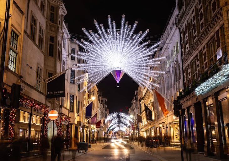 Peacock feather Christmas lights over Bond Street in Mayfair, London