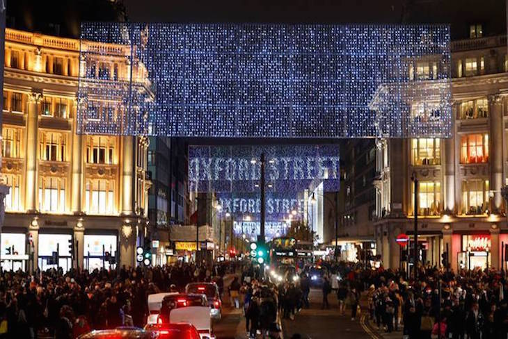 The new Oxford Street Christmas lights for 2019 - blue LED screens hanging above Oxford Street and Oxford Circus