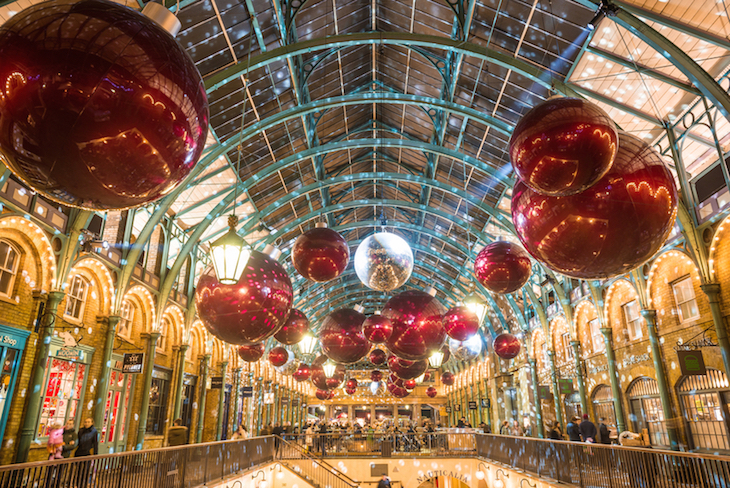 Giant bauble and mistletoe Christmas decorations in Covent Garden, London