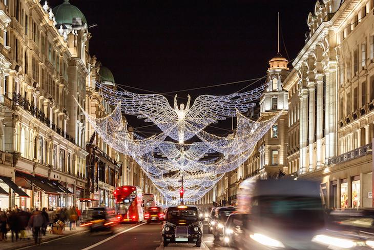 Illuminated angel Christmas lights hanging above Regent Street, London
