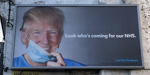 Trump Appears On This Terrifying NHS Billboard In West London