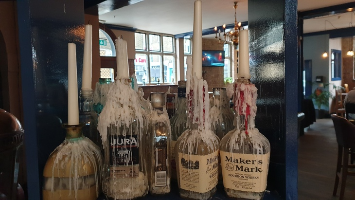 Candles in glass bottles