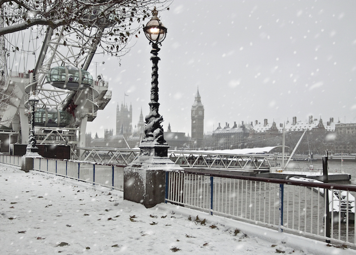 Thick snow on the ground next to the London Eye