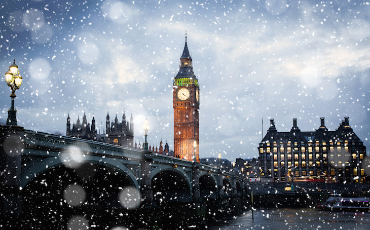 Snow falling at Big Ben and Westminster Bridge, London