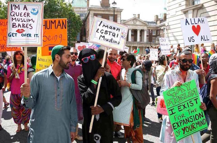 People march with placards at Muslim Pride