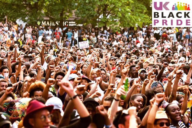 A crowd of people facing the stage at Black Pride UK