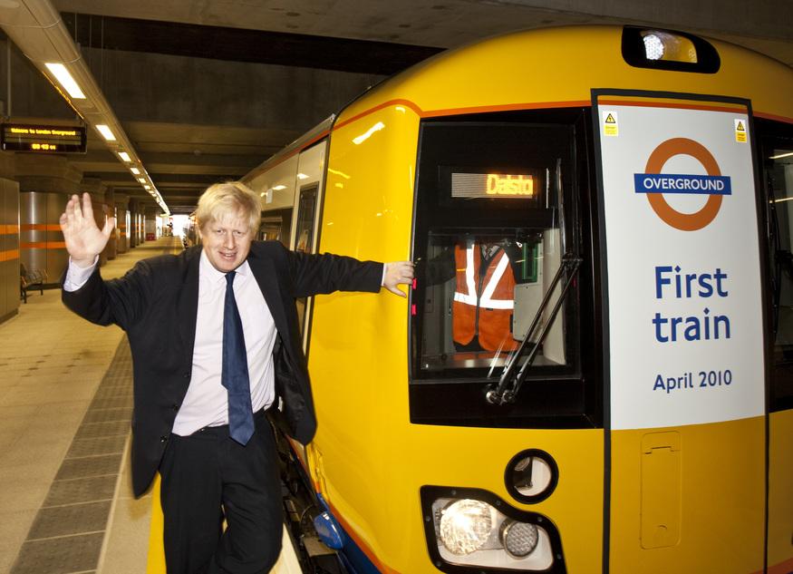 Boris Johnson poses with an Overground train