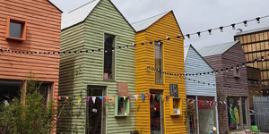 This North London Shopping Centre Is Made Of Colourful Sheds And A Converted Bus