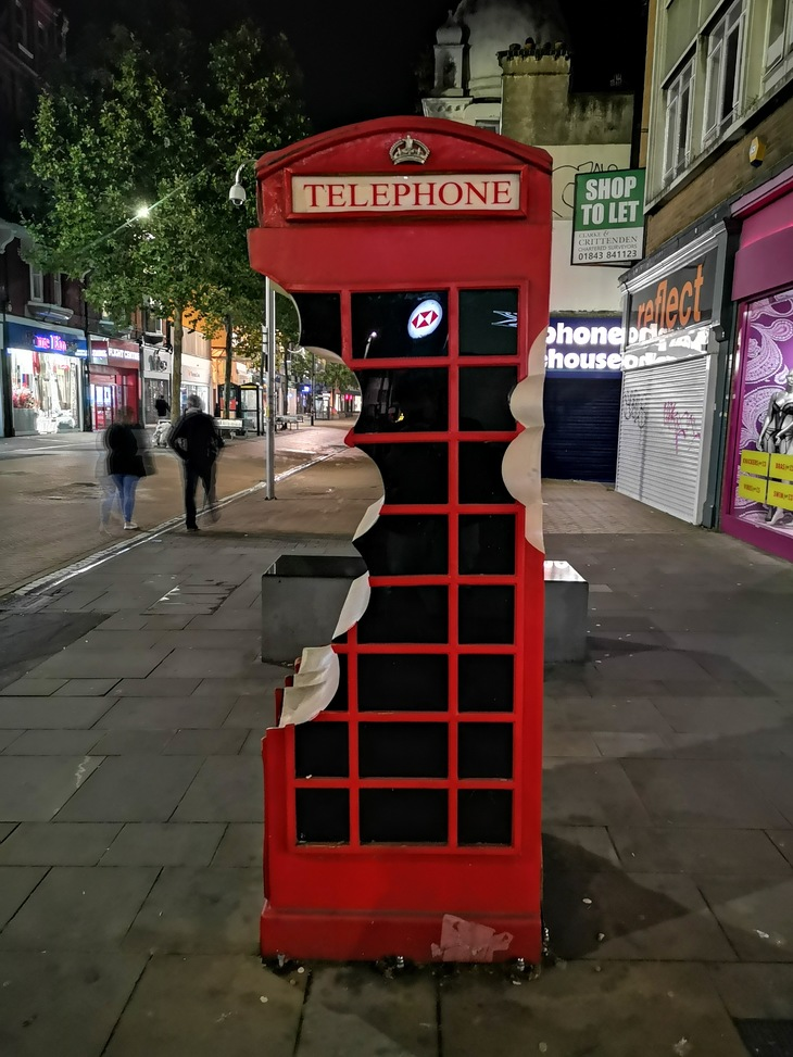 A sculpture of a phone box in Croydon with bites taken out of it
