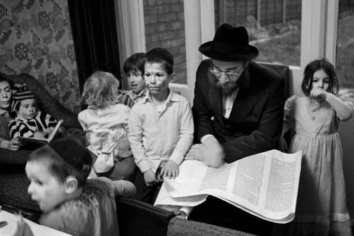 Jewish man reading to children