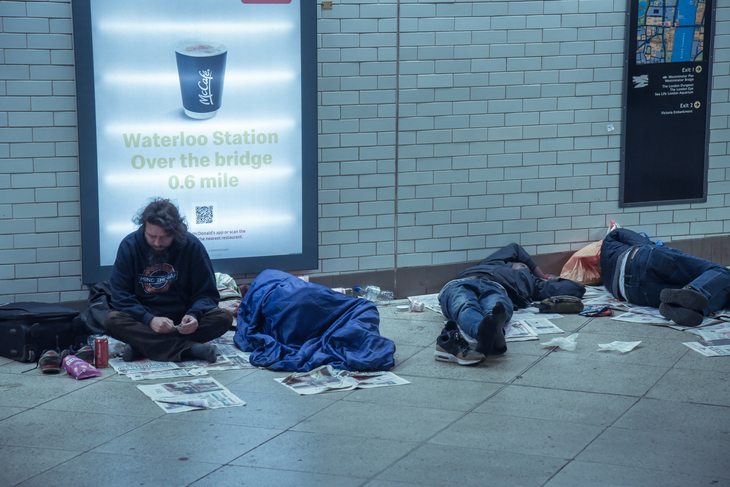 Homeless people in a subway in London