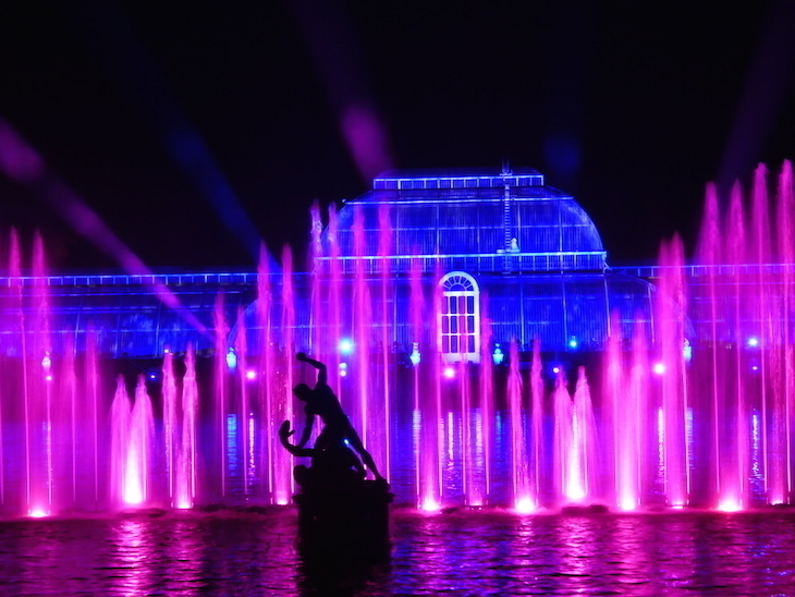 Dancing illuminated fountains in front of the Palm House at Christmas at Kew
