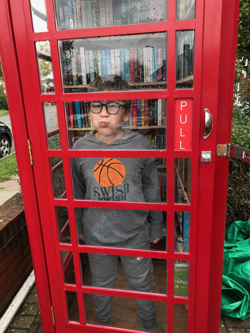 Child in a phone box