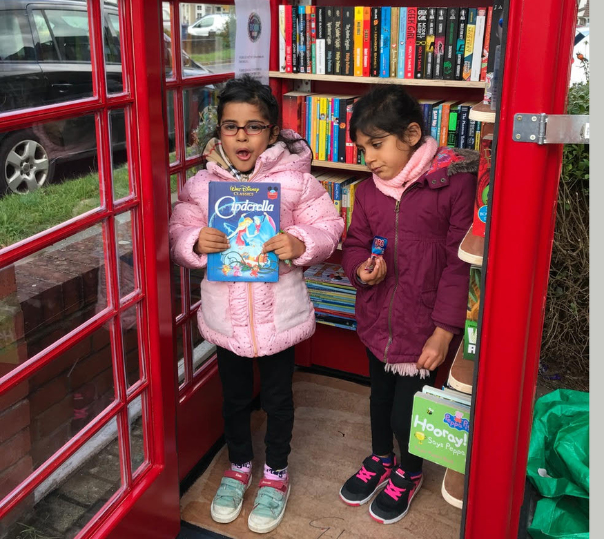 Kids in phone box