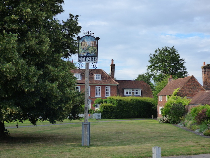 A village green with elevated sign reading 'Otford' and an illustration of the village