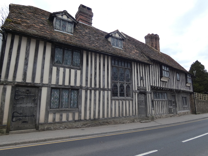 A beige and wood timbered building with oak doors, on Otford High Street