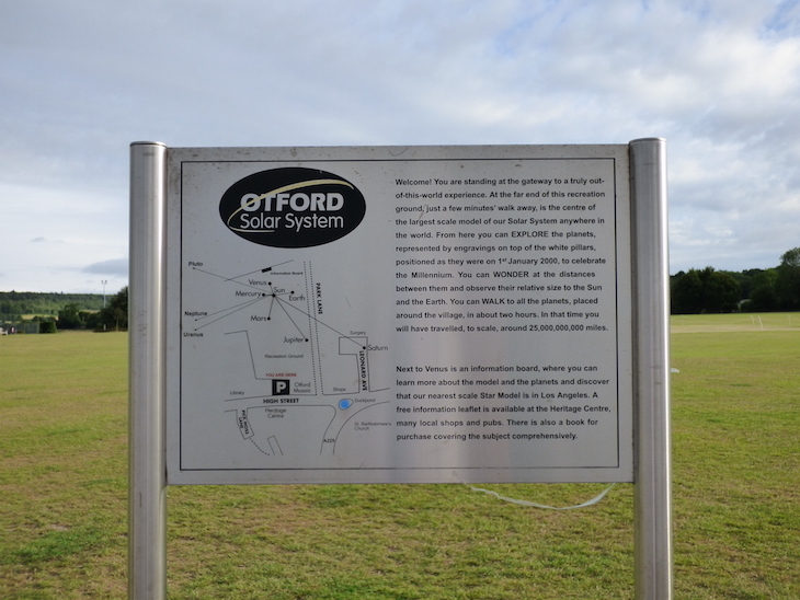 An information board on the edge of Otford Recreation Ground, detailing the Otford Solar System Walking Route