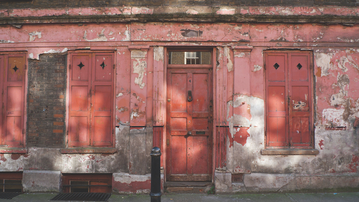 The deliberately shabby pink front of a house on Princelet Street