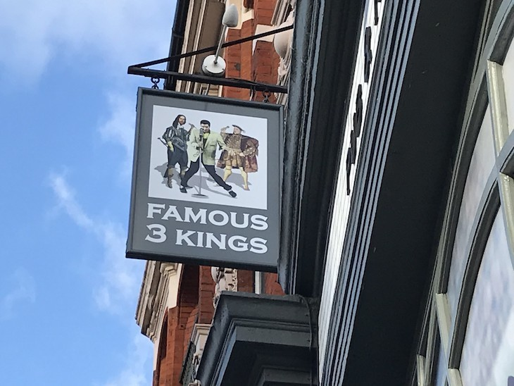 The hanging sign of the Famous Three Kings pub