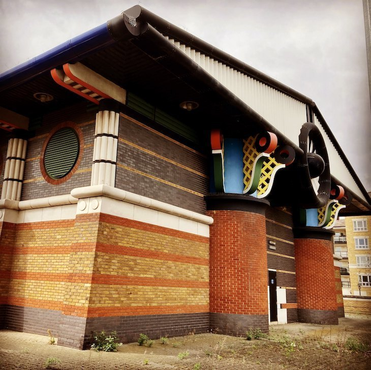 Postmodern pumping station on the Isle of Dogs with colourful capitals