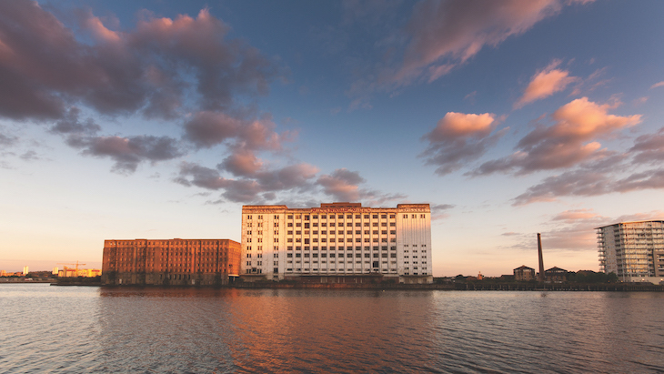 The shell of Millennium Mills in the Royal Docks, at sunset