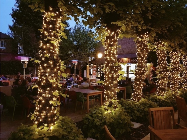 The Eagle's beer garden at night.