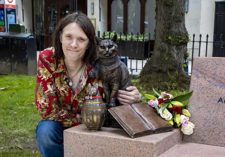 James Bowen with Bob's statue.