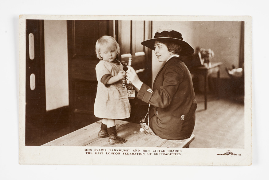Sylvia Pankhurst playing with a child in the Mothers Arms