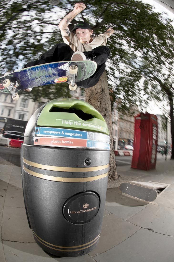 doing an ollie on a bin