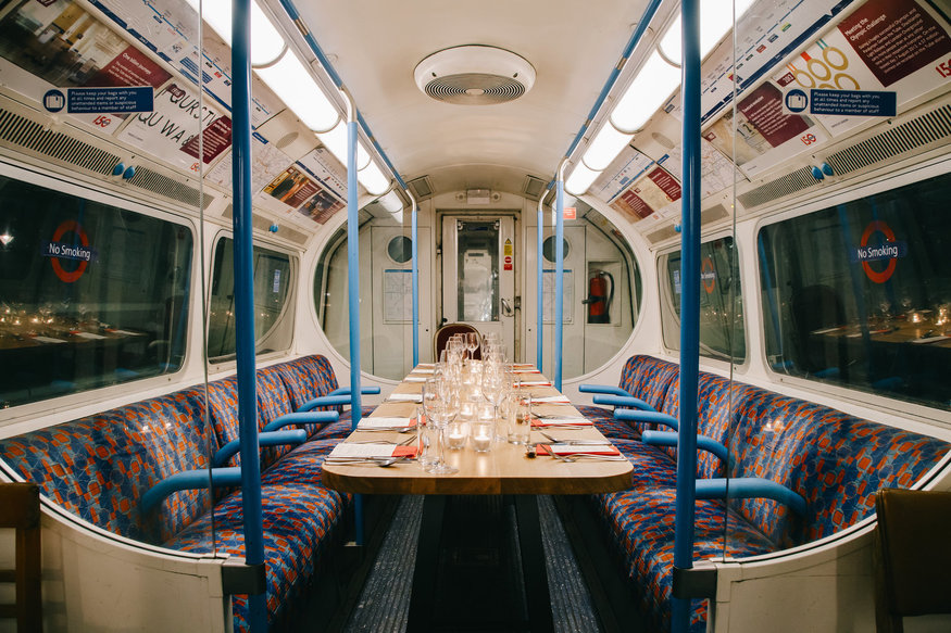 The inside of a vintage victoria line carriage, ready to serve dinner