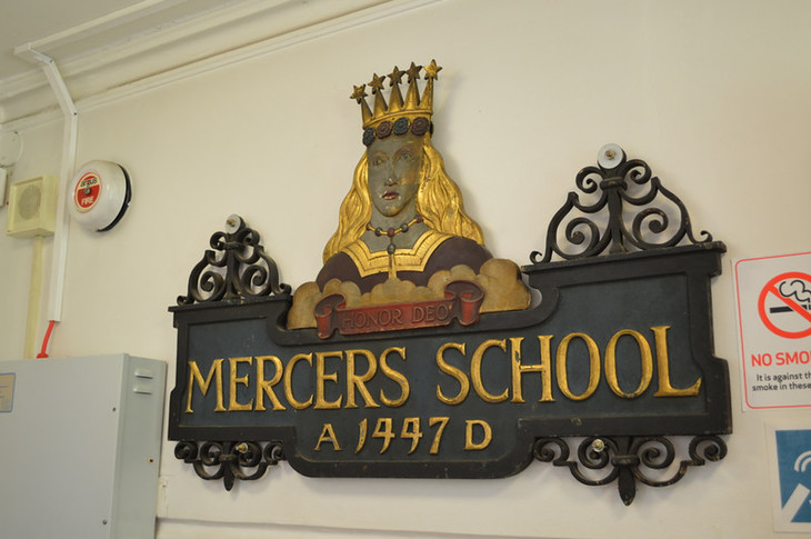 A wooden sign saying Mercers School.