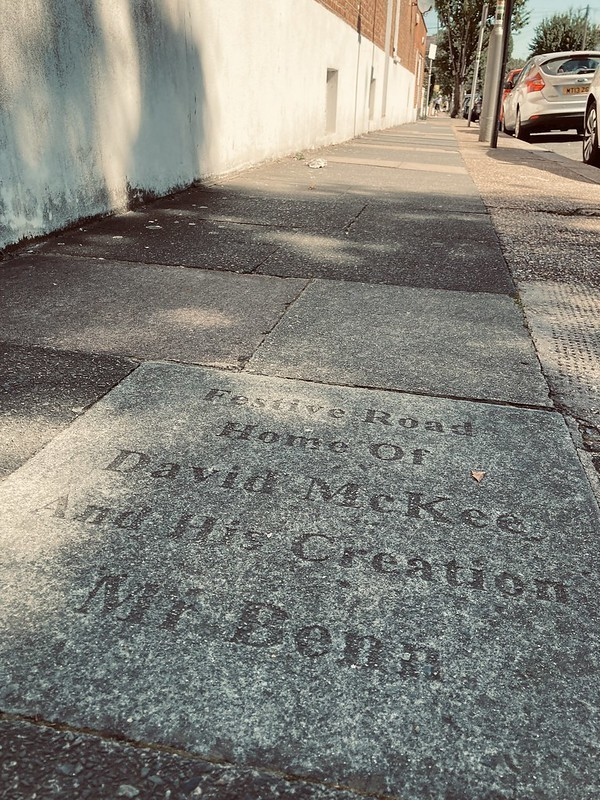 A sadly faded paving stone commemorating Mr Benn and creator David Mckee.