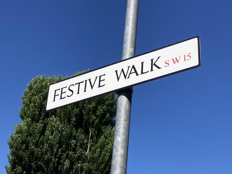 A street sign saying FESTIVE WALK SW15