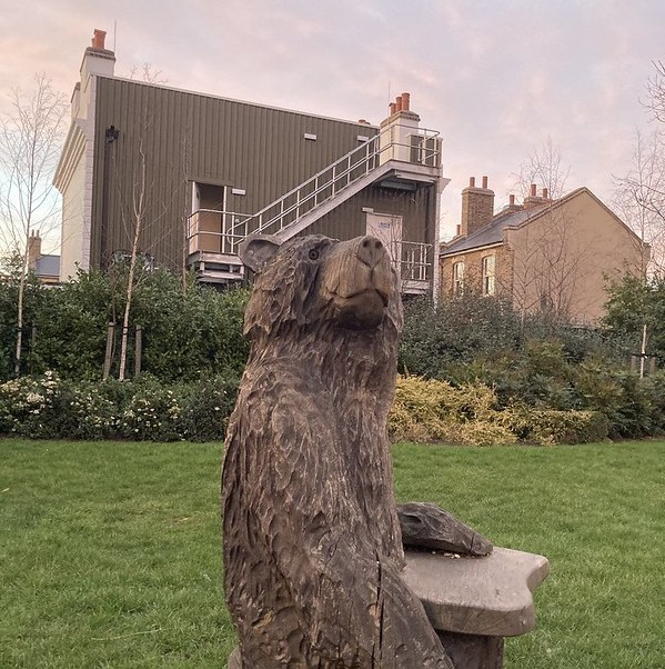 A wooden bear stands proud before the Albert Square film set.