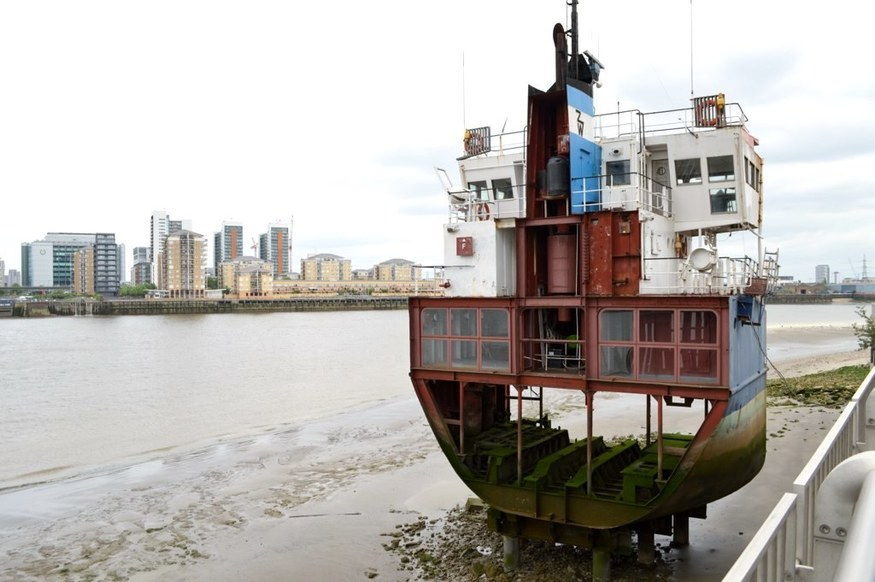 slice of reality - a ship cut down the middle - on the muddy banks of the thames